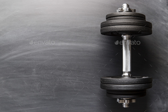 Dumbbell with black weight. - Stock Photo - Images