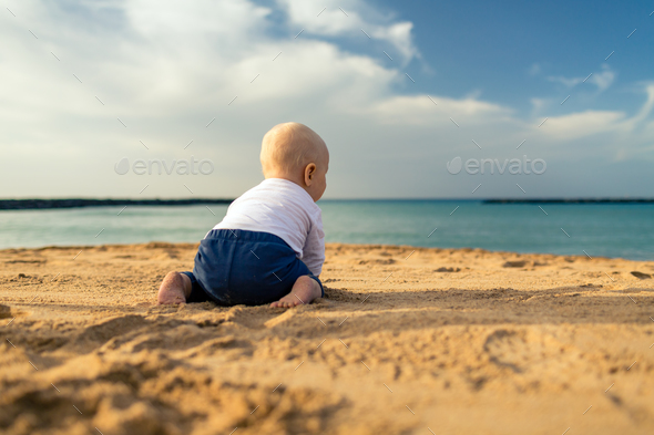Baby boy playing on a beach - Stock Photo - Images