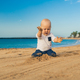 Baby boy playing on a beach - PhotoDune Item for Sale
