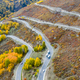 aerial view of autumn winding mountain road,xinjiang kanas, China - PhotoDune Item for Sale