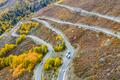aerial view of autumn winding mountain road,xinjiang kanas, China - PhotoDune Item for Sale