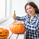 Close up of woman with pumpkins preparing to halloween. - PhotoDune Item for Sale