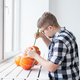 Hollowing out a pumpkin to prepare halloween lantern. - PhotoDune Item for Sale