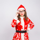 Woman in santa suit took off glasses on white background with copy space - PhotoDune Item for Sale