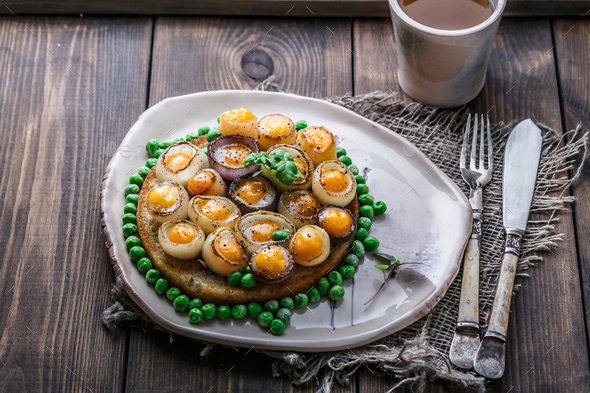 Fried quail eggs and onion on toasted bread, copy space, top view - Stock Photo - Images