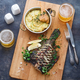 Delicious baked flounder with potato gratin and beer, top view. - PhotoDune Item for Sale
