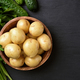Raw potatoes in wooden bowl - PhotoDune Item for Sale
