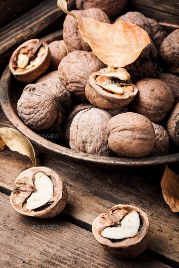Walnuts on a wooden table - Stock Photo - Images