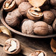 Walnuts on a wooden table - PhotoDune Item for Sale