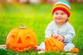 Cute baby with Halloween pumpkins - PhotoDune Item for Sale