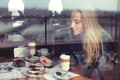 Nice female in cafe eating cake - PhotoDune Item for Sale