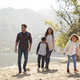 Parents and children hiking by a mountain lake in sunshine - PhotoDune Item for Sale