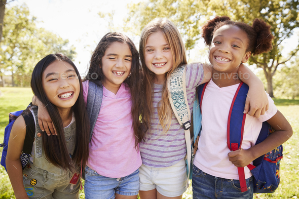 Four young smiling schoolgirls on a school trip - Stock Photo - Images