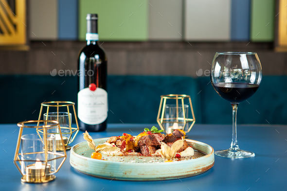 Tasty restaurant gastronomy with red wine on the table - Stock Photo - Images