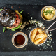 Burger and friench fries on black stone table , cheese tomato and soia sos - PhotoDune Item for Sale