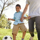 Father And Son Playing Soccer In Park Together - PhotoDune Item for Sale