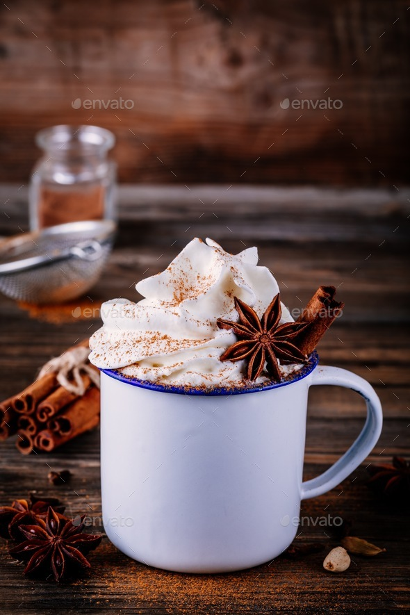 Hot chocolate drink with cinnamon and whipped cream. - Stock Photo - Images