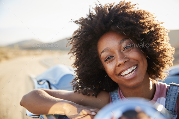 Portrait Of Woman Enjoying Road Trip In Open Top Classic Car - Stock Photo - Images