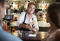 Barman Serving Cocktail To Female Customer In Bar - PhotoDune Item for Sale