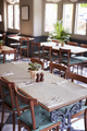 Tables Laid For Service In Empty Restaurant - PhotoDune Item for Sale