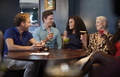 Group Of Young Friends Sitting Around Table In Bar Together On Night Out - PhotoDune Item for Sale