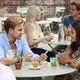 Couple Sitting At Table In Pub Garden Enjoying Drink Together - PhotoDune Item for Sale