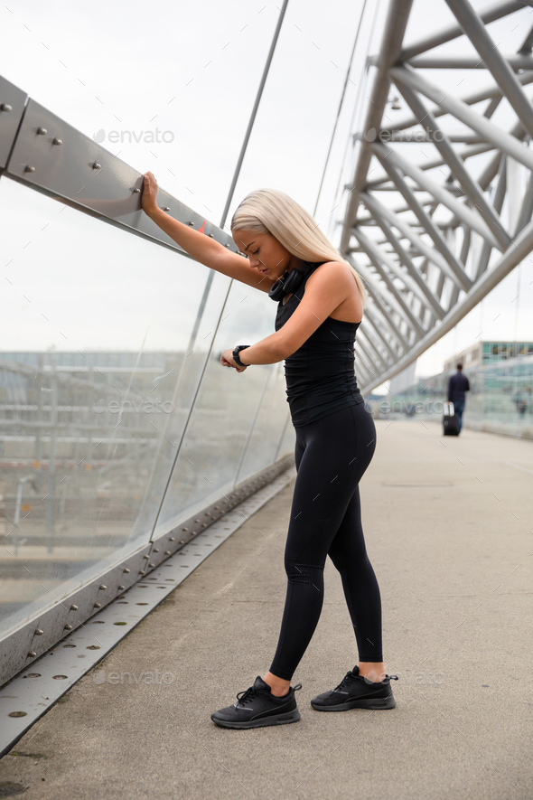 Woman Checking Heart Rate Using Smartwatch After Workout On Bridge - Stock Photo - Images