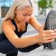 Beautiful Urban Female Stretching Her Leg Before Exercise - PhotoDune Item for Sale