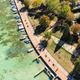 Aerial view of Annecy lake waterfront low tide level due to the - PhotoDune Item for Sale