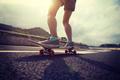 Riding skateboard on asphalt road - PhotoDune Item for Sale