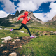 Jumping over creek on high altitude mountins - PhotoDune Item for Sale