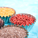 Various superfoods in small bowl on blue background - PhotoDune Item for Sale