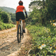 Cycling Woman cyclist riding mountain bike on rocky trail  - PhotoDune Item for Sale