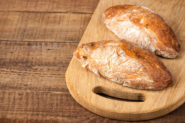 Ciabatta buns on wooden table - Stock Photo - Images