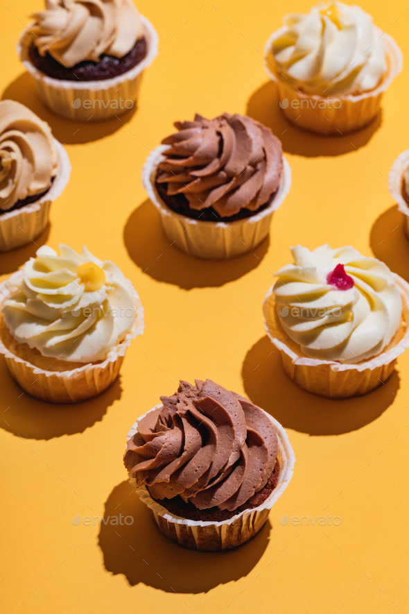 Bunch of muffins on yellow background. - Stock Photo - Images