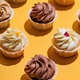 Bunch of muffins on yellow background. - PhotoDune Item for Sale