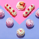 Sweet desserts in a pastel triangular composition. - PhotoDune Item for Sale