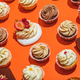 Colorful desserts laying on orange background. - PhotoDune Item for Sale