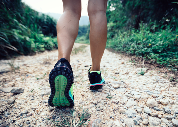 young fitness woman trail runner legs running on forest - Stock Photo - Images