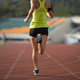 RunningSportswoman running on stadium - PhotoDune Item for Sale