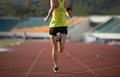 RunningSportswoman running on stadium - PhotoDune Item for Sale