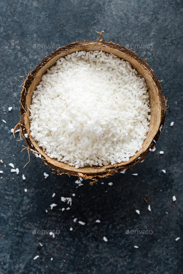 Coconut flakes in bowl - Stock Photo - Images
