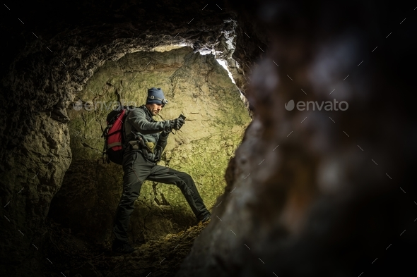 Deep Cave Exploration by Men - Stock Photo - Images