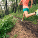 Woman trail running in green forest. Endurance sport. - PhotoDune Item for Sale