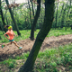 Young woman running in green forest. Endurance sport. - PhotoDune Item for Sale