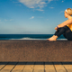Yoga girl meditating and relaxing in yoga pose, ocean view - PhotoDune Item for Sale