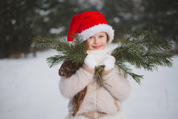 little happy beautiful girl in winter forest - Stock Photo - Images