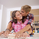 Happy mother and daughter making dinner together - PhotoDune Item for Sale