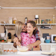 Mother with her daughter cooking in the kitchen - PhotoDune Item for Sale