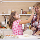 Young mother and her teenage daughhter playing with flour while making delicious food - PhotoDune Item for Sale